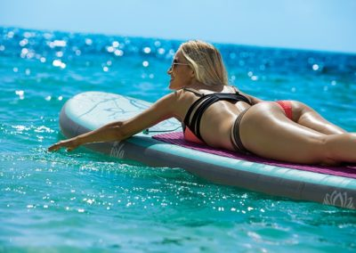 breathless-riviera-cancun_woman_surfboard_2a
