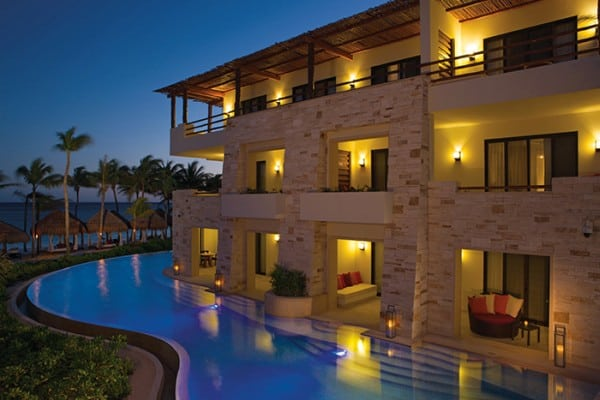 secrets-akumal-deal_ext_swimoutsuites_night_1a